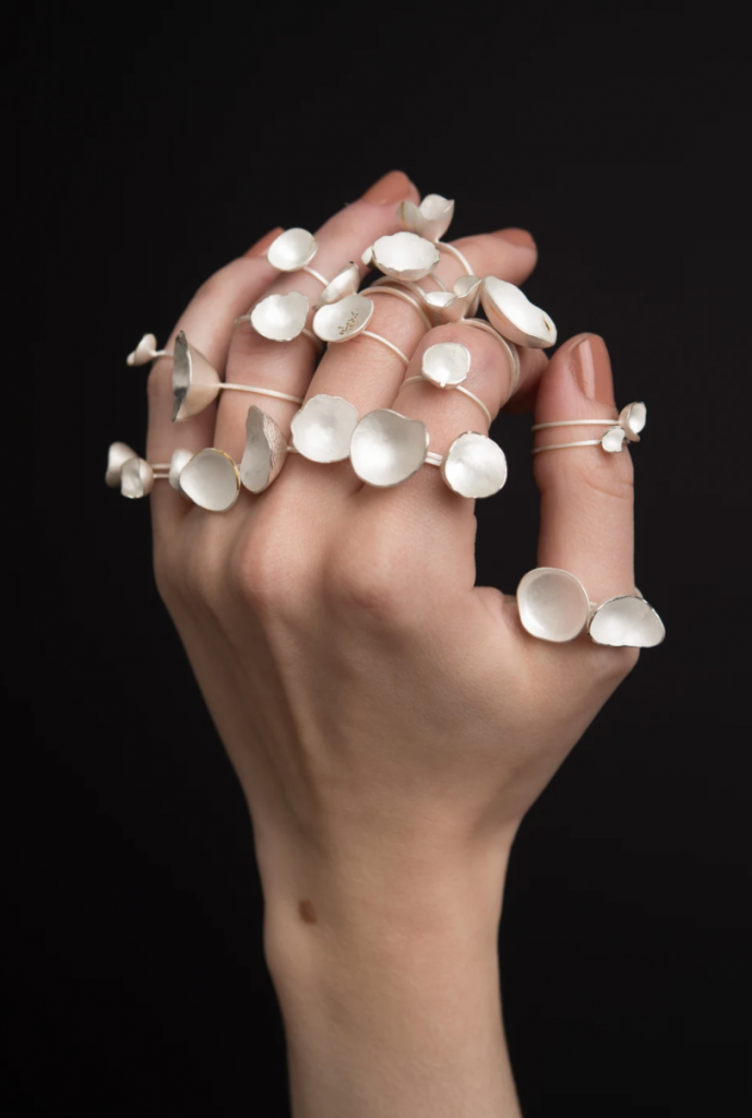 white metal rings with small cups